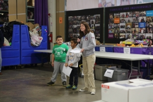 City Connects' Sarah O'Connor is joined by two GPA student volunteers at Cradles to Crayons' Family Volunteer Day